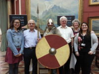 Friends volunteers posing with an Anglo-Saxon soldier at the Staffordshire Hoard themed evening opening of BMAG